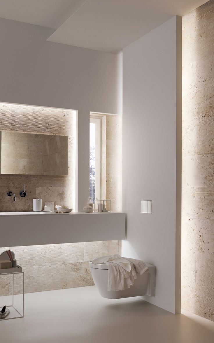 Geberit toilet systems. Love the bathroom design with the hidden lighting//
