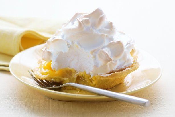 Individual lemon meringue pies - crispy base, tangy citrus centre and fluffy meringue top.