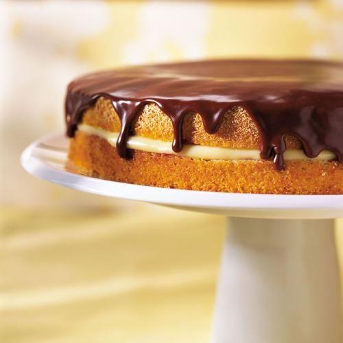 Le gâteau Boston (Boston cream pie) est un délicieux gâteau à étages garni d'une crème à la vanille et recouverts d'un succulent glaçage chocolaté, de quoi plaire aux jeunes et aux moins jeunes.