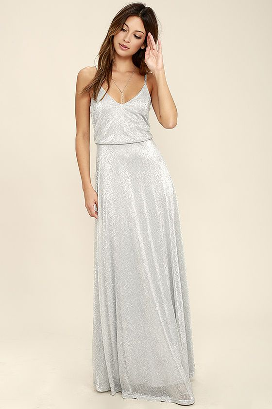 All the glamour seekers know that an amazing night starts with the Friend of the Glam Silver Maxi Dress! Grey knit, with metallic silver threading, sparkles over adjustable spaghetti straps and a relaxed triangle bodice. Fitted waist tops the lovely maxi skirt. Hidden back zipper with clasp.
