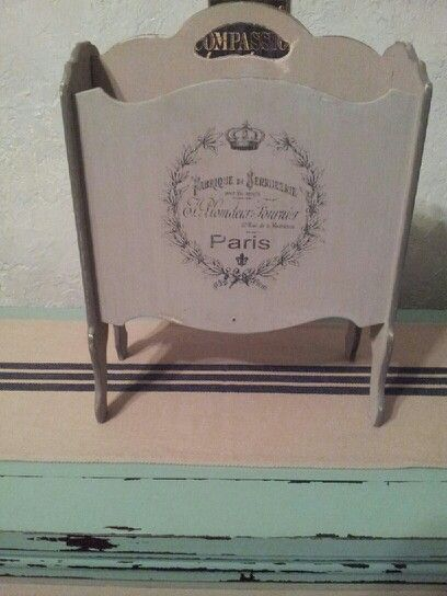 My chalk painted vintage,magazine rack,that I,put some,French,script on.