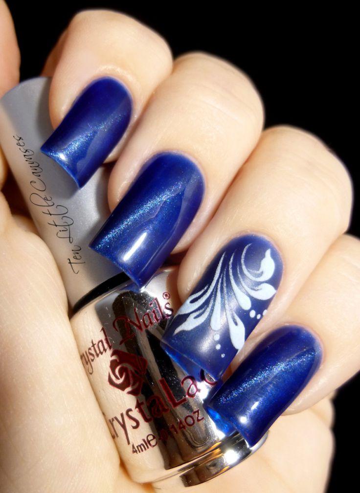new mani crystal nails blue tiger eye polish with hand drawn accent nail ten
