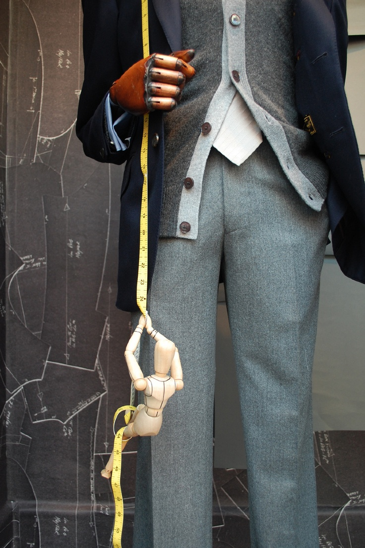 I love the use of the wooden mannequins as tailors.  hackett