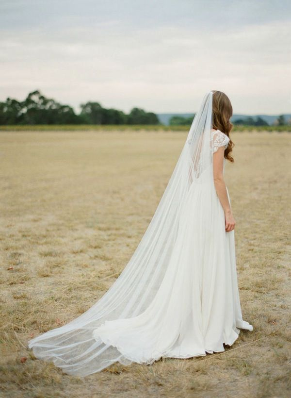 The Dahlia chapel length veil takes classic minimalist to a new level. The soft-as-silk tulle radiates beauty in an almost unimaginably simple way.
