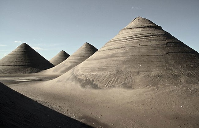 You'd never guess that these pyramid-like sand formations were found in a parking lot in Queens, New York. The 30-foot tall dunes are just one example of the expansive destruction caused by Hurricane Sandy. You might expect to find a scene like this in a desert. Or perhaps even the moon.