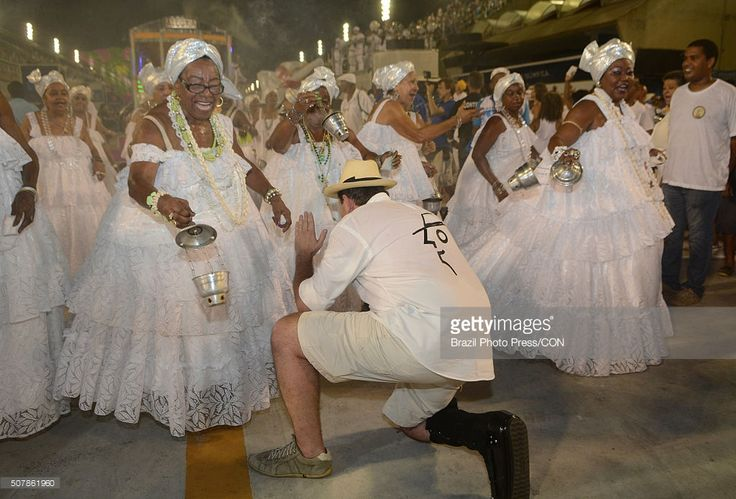 The mayor of Rio de Janeiro Eduardo Paes takes part during the traditional washing of the Sambadrome, which brings together several of Bahian samba schools in Rio de Janeiro at Marques de Sapucai Avenue on January 31, 2016 in Rio de Janeiro, Brazil.