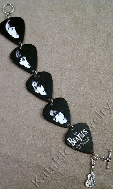 Great guitar pick bracelet with John Lennon, Paul McCartney, George Harrison, and