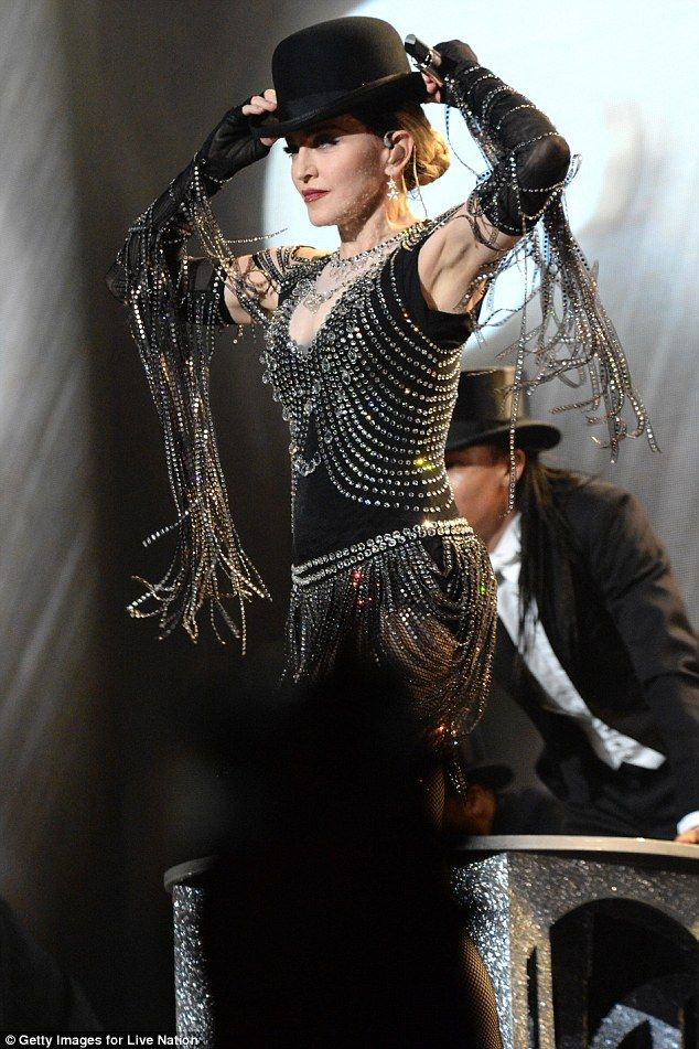 Bejewelled: Madge's sparkling outfit was covered in crystals, while she donned a black bowler hat