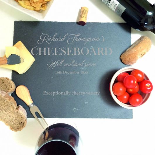Slate Cheese Board.    A fun and fabulous cheese board perfect as a Christmas gift to any cheese lovers. Can be personalised with a family or individual's name.    Our Personalised Slate Cheeseboard is beautifully hand-crafted in Yorkshire and makes a fantastic gift any time of the year for a cheese lover.