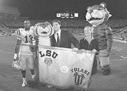 """LSU mascots Mike the Tiger and retired inflatable mascot Ellis Hugh with """"the Rag"""" - awarded to the winner of the LSU-Tulane game."""