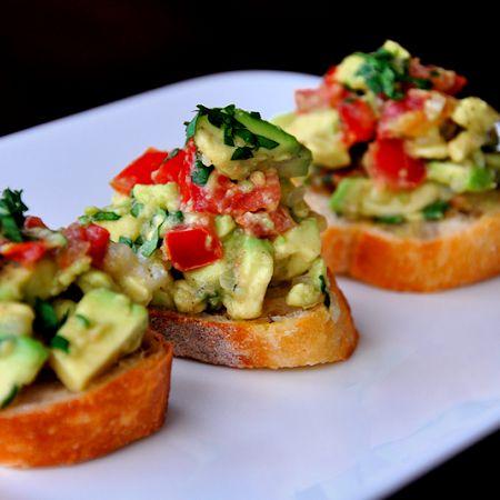 "Guacamole Bruschetta! Two of my favorite foods in one! (on ""whole"" grain bread)"