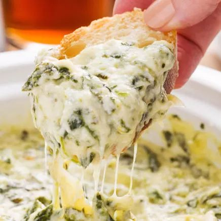 This CREAMY Crockpot Spinach-Artichoke Dip Will Change Your Life Forever
