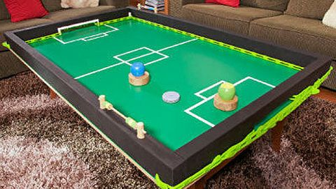 How to make a slide soccer table: You'll have a good time making and playing this tabletop game. It's based on the popular indoor sport of air hockey and, by containing play to the top of a table, there's plenty of room for your cheer squad.