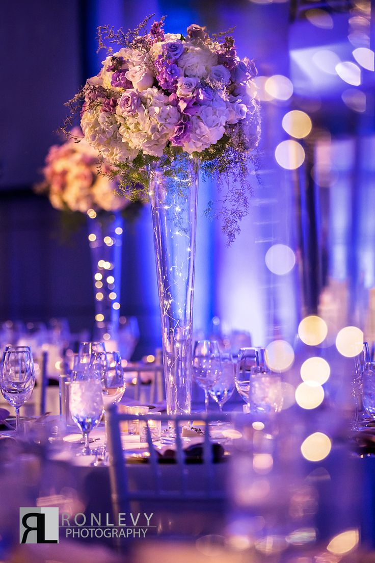 Tall centerpiece - Twinkle lights - market lights - starry night sky theme - Purple - Lavender - Gold - White - Wedding - Bat Mitzvah - Sweet 16 - Skirball Cultural Center - Ahmanson Ballroom - PC: Ron Levy Photography - Design and Planning from www.DBCreativity.com