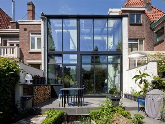 interesting! a two-story glass house extension in Rotterdam, the Netherlands. the the floor of the 2nd story is glass. 2nd story is a study.