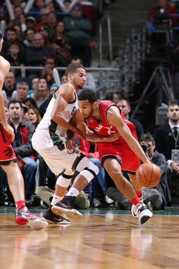 MILWAUKEE, WI - DECEMBER 26:  Cory Joseph #6 of the Toronto Raptors goes to the basket against the Milwaukee Bucks on December 26, 2015 at BMO Harris Bradley Center in Milwaukee, Wisconsin. Description from gettyimages.com. I searched for this on bing.com/images