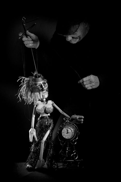 Art photography - studio portrait.  Puppet and puppeteer.