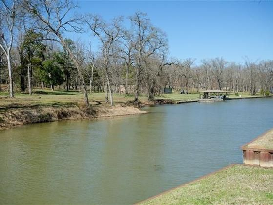 Beautiful heavily treed waterfront home site in the prestigious Wilderness subdivision. This 2.029 acre waterfront lot is located on a protected canal with steel retaining wall with boat slip cut out. Great building site back off road for privacy. The Wilderness is one of the most prestigious gated communities on Richland Chambers Lake. It offers a boat ramp and clubhouse to its owners is deed restricted to site built homes and is known for the friendly deer that roam the wilderness.