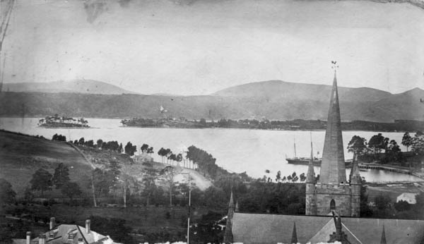 """Port Arthur - 1870s: Dead Island and Point Puer; the ship """"Bridgewater"""" is at the jetty"""