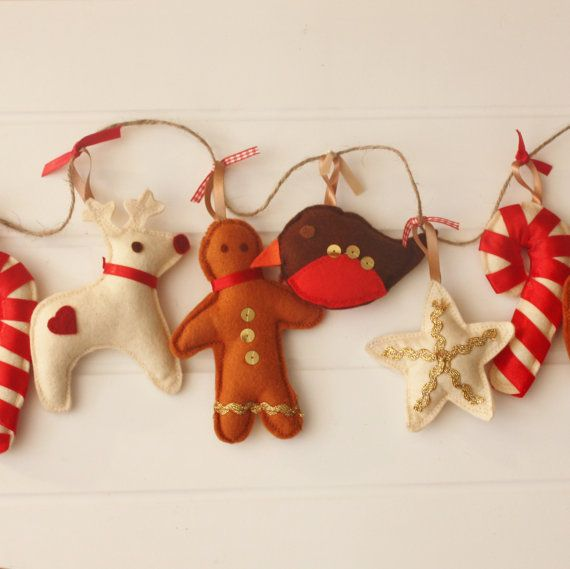 This beautiful traditional garland Christmas decoration will make an amazing keepsake which fits perfectly along a fireplace or door frame. The garland is made from 9 handmade felt Christmas shapes which have been carefully created and decorated.  Each shape has been individually designed, handcut and embellished with hand stitched details and hang on twine with ribbon ties, measuring approx 1m 50cms in total. Loops at either end can be used to hang the garland.  Please see other lovely soft…