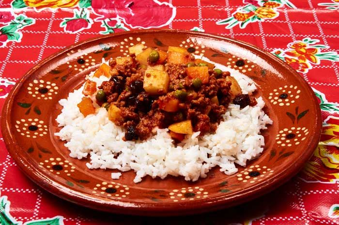 Mexican Style Ground Beef Dish If you are tired of typical ground beef dinners try making Picadillo (pea-KA-dee-yo), a flavorful but not hot Mexican ground beef dish. Raisins add a touch of sweetness; tomato sauce adds tang. How to Make Picadillo Start by gathering all of your ingredients for the recipe: ground beef, potatoes, carrots, green peas, raisins and tomato sauce. Seasoned or unseasoned tomato sauce both work well in this dish. It is more typical in Mexico to use seasoned tomato…