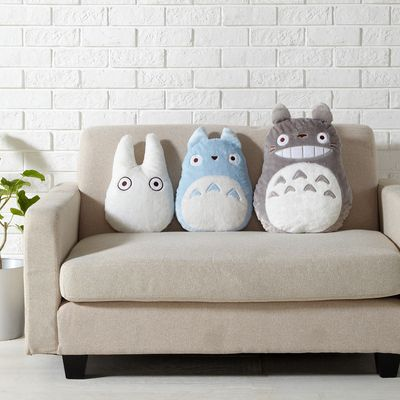 3 Totoro Plushies on a sofa