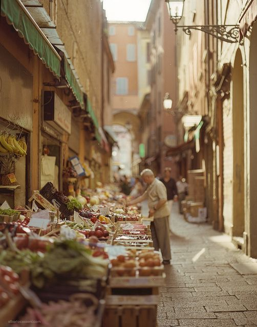 """Narrow street with fresh produce to be sold in Bologna.   Italians are all about the """"slow food"""" movement.  Picking produce daily for the freshest of ingredients...they savor meals and local flavors."""
