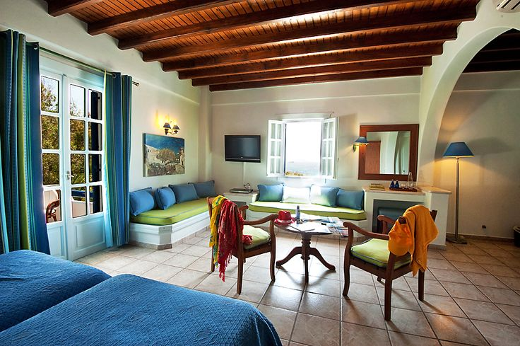 Cyclades Junior Suites. Cycladic Junior Suites are spacious and include a living room area consisting of one or two sofas that can be used for sleeping. They are elegantly decorated with rich color schemes that complement the traditional Cycladic style of the Hotel.