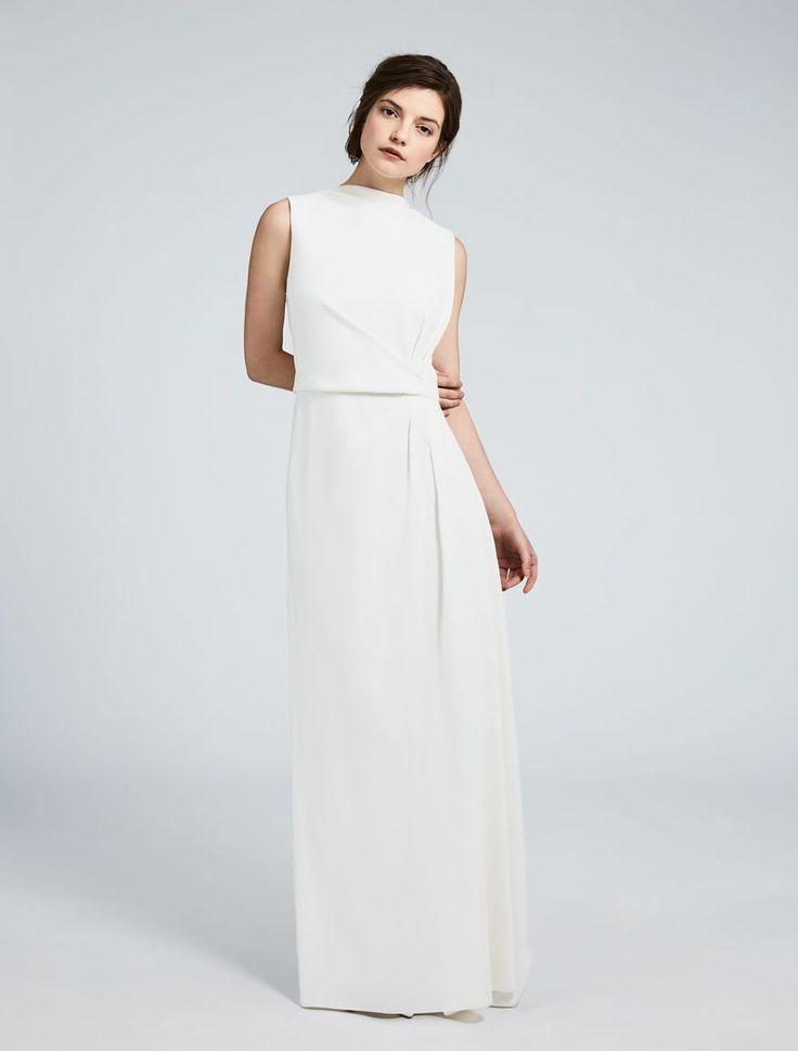 TIMO, long sleeveless dress in milk-coloured cady, embellished with draping and asymmetry. #MaxMaraBridal #weddingdress #abitodasposa