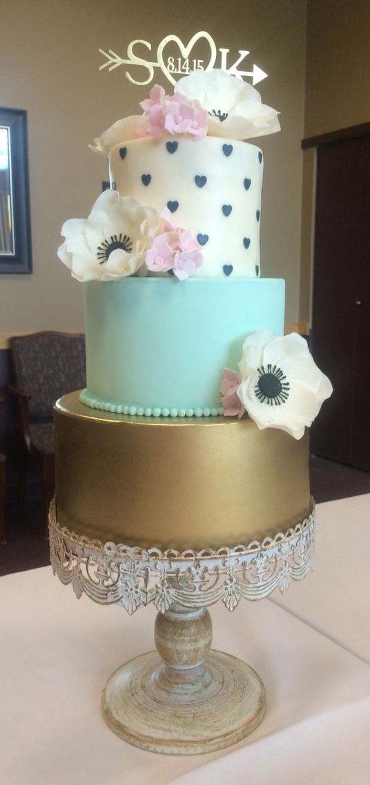 Wedding Cake By Ola White Gum Paste Anemones, Pink Hydrangeas, Mint, Gold, and Navy Blue Hearts.