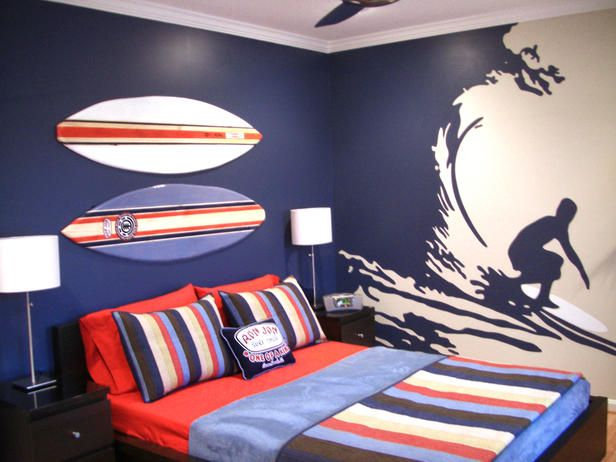 Hand-Painted Mural: It's all about the hand-painted wall mural in this beach-inspired boy's room. Two surfboards create a headboard space, while striped linens add a calming Hawaiian feel. Design by RMS user lizardshop