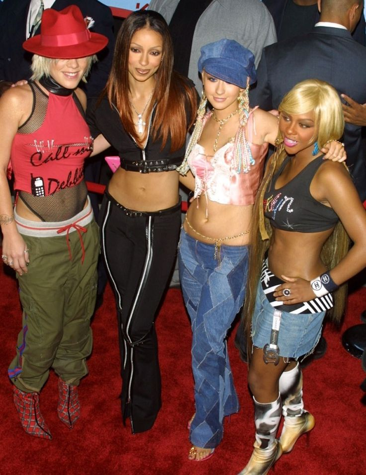 2000 fashion- LOW RISE jeans designed to sit below the wearers waist and expose the area below the belly button were influenced by the hip hugger styles of the 1970s. Brought back into fashion by such musical icons as Britney Spears these jeans quickly became popular with teens.