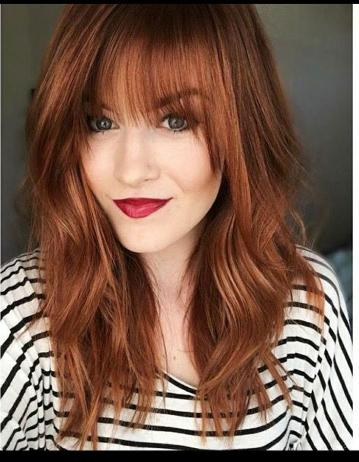 Bold red with bangs. Love the cut too!