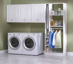 Laundry in garage designs. I like that it includes a place to hang stuff fresh out of the dryer so it doesn't get all wrinkled.