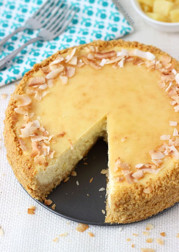PIñA COLADA CHEESECAKE~ Crust: 1¾ cup shortbread cookie crumbs (15-20 cookies), 1 cup coconut flakes, ½ cup macadamia nuts, 4 tbsp unsalted butter. Filling: 24 oz cream cheese, ½ cup granulated sugar, 3 eggs, ¾ cup cream of coconut, ¼ cup Caribbean Rum with Coconut liqueur, 3 tbsp milk, zest of one orange, 2 tsp coconut extract, 1 can (8 oz) crushed pineapple. Topping: ½ cup reserved pineapple juice, 2 tsp cornstarch, ¼ cup sugar. Garnish: 1 can (8oz) pineapple chunks, toasted coconut…