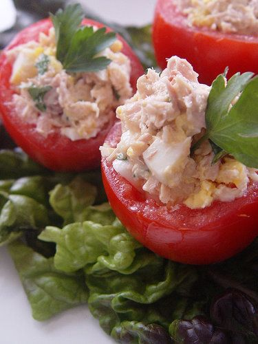 Tuna with avocado and hard boiled egg in a tomato