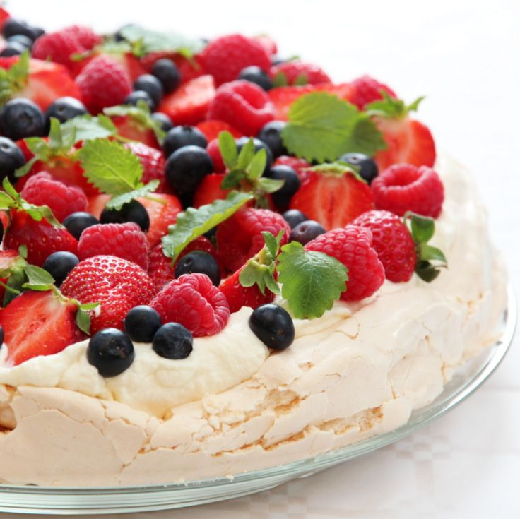Pavlova with cream and berries.