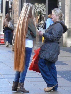 Long blonde hair down to her calves