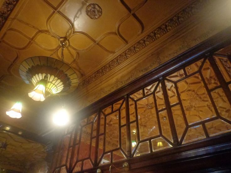 Philharmonic Dining Rooms, Photograph taken of the dining halls wall, ceiling and Chandelier/Light.
