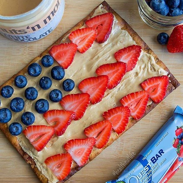 """@healthnutlife is continuing the 4th of July celebration with a baked @questnutrition bar topped with @nutsnmore WHITE CHOCOLATE peanut butter!! _______________________________ #nutnation #nutsnmore #peanutbutter #poweredbypeanutbutter #fueledbynutbutter #protein #fitfam #fitfood #macros #orange4life #fitness #delicious #breakfast #dessert #health #healthy #fortifiedbutter #almondbutter #iifym #jerf #4thofjuly #red #white #blue #celebration"""