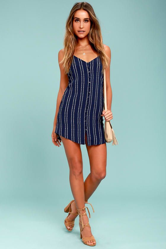 Lulus Exclusive! The Stripe a Chord Navy Blue Striped Button-Up Dress is like a love song come to life! Dreamy, navy blue woven rayon is bedecked in a white striped print that covers the triangle bodice with adjustable spaghetti straps, and low-dipping back.. Full button placket and sheath silhouette.