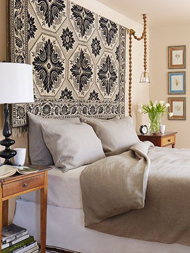 In the master bedroom, Smith hung an 1854 textile in place of a headboard. The wall art is actually pressed sea kelp, purchased at a flea market during a vacation in Paris. #countryliving #bedrooms