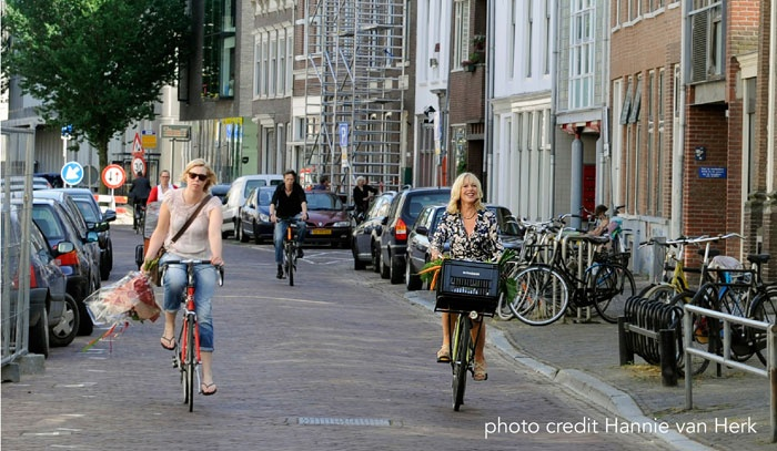 Cycling in Amsterdam - arriving at dinner 'local-style'!