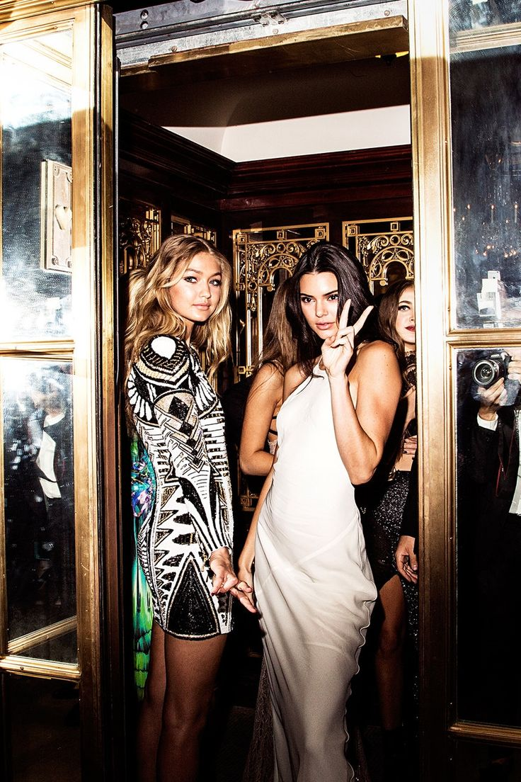 Gigi Hadid and Kendall Jenner stopped by the Harper's Bazaar party at the Plaza Hotel barely long enough to flash a peace sign. (Photo: Amy Lombard for The New York Times)