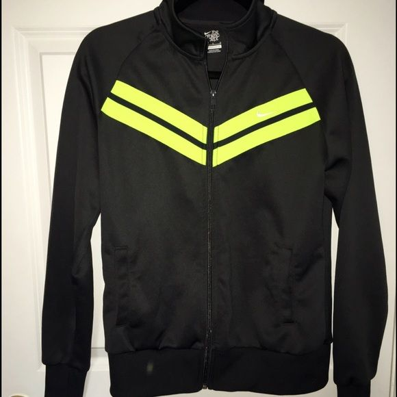 Nike charcoal zip up jacket Adult S-M (Youth L) charcoal color with neon yellow stripes. Great condition, one small pull on the back (in last picture) but not noticeable At all. make me an offer! smoke free home   NOTE: this jacket is actually a boy's large. it fits like a women's medium. I didn't realize that it was in boy's sizing!   feel free to ask questions :) Nike Tops Sweatshirts & Hoodies
