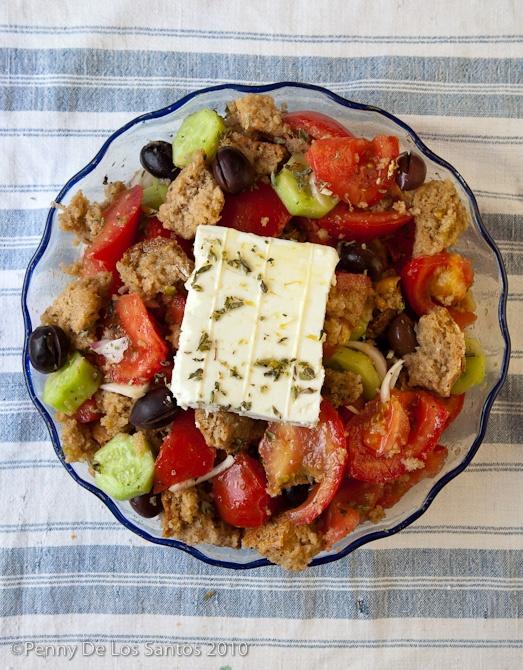 Food in Greece by Penny De Los Santos - cretan rusks, tomatoes, onions, olives, cucumbers, feta, oregano & olive oil, of course!
