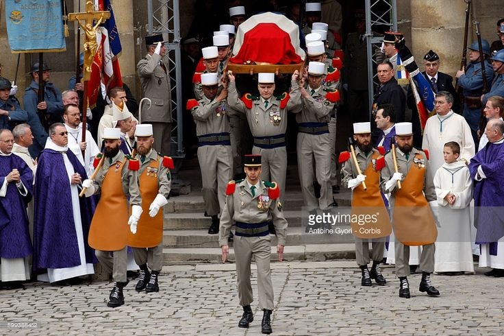 Members of the Foreign Legion carry the flag-draped coffin of Lazare Ponticelli, France's last surviving World War I veteran, at a ceremony to pay tribute to the dead of the Great War during a state funeral at the Invalides. Ponticelli, an Italian immigrant who joined the Foreign Legion as a 16-year-old at the outbreak of the war with Germany in 1914, died at the age of 110.