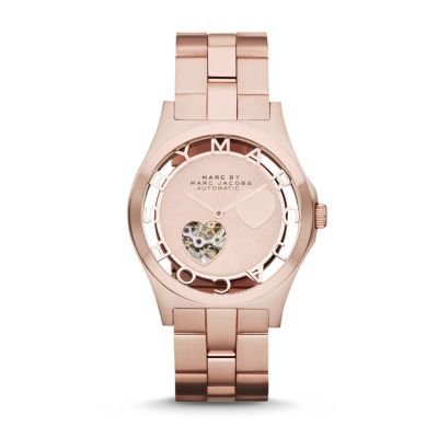 Sale 	 	Henry Icon Automatic Heart Dial Watch Merging whimsical spirit and geometric design with functionality, this rose gold-tone stainless steel Henry automatic watch features a sunray skeleton dial accented with iconic hearts and signature logo markers.