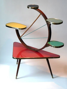This crazy atomic display table and/or plant stand. Wonderful piece.