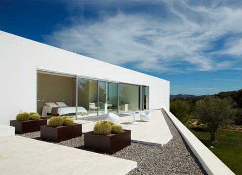 Modern terrace at Villa Ixos in Ibiza by Bruno Erpicum